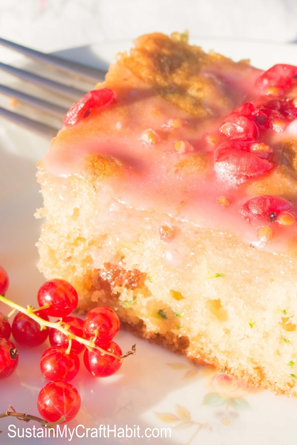 This easy zucchini cake recipe is a delicious dessert alternative to zucchini bread. Filled with tart berries of your choice such as currants and raspberries, and topped with a simple icing sugar glaze, it's perfect for potlucks, picnics and summer BBQs! #zucchini #zuchinni #cake #sweet #familyfriendlyrecipe #redcurrants #zucchinicake #sustainmycookinghabit