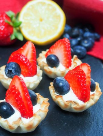 Berry phylo cups filled with fresh strawberries and blueberries