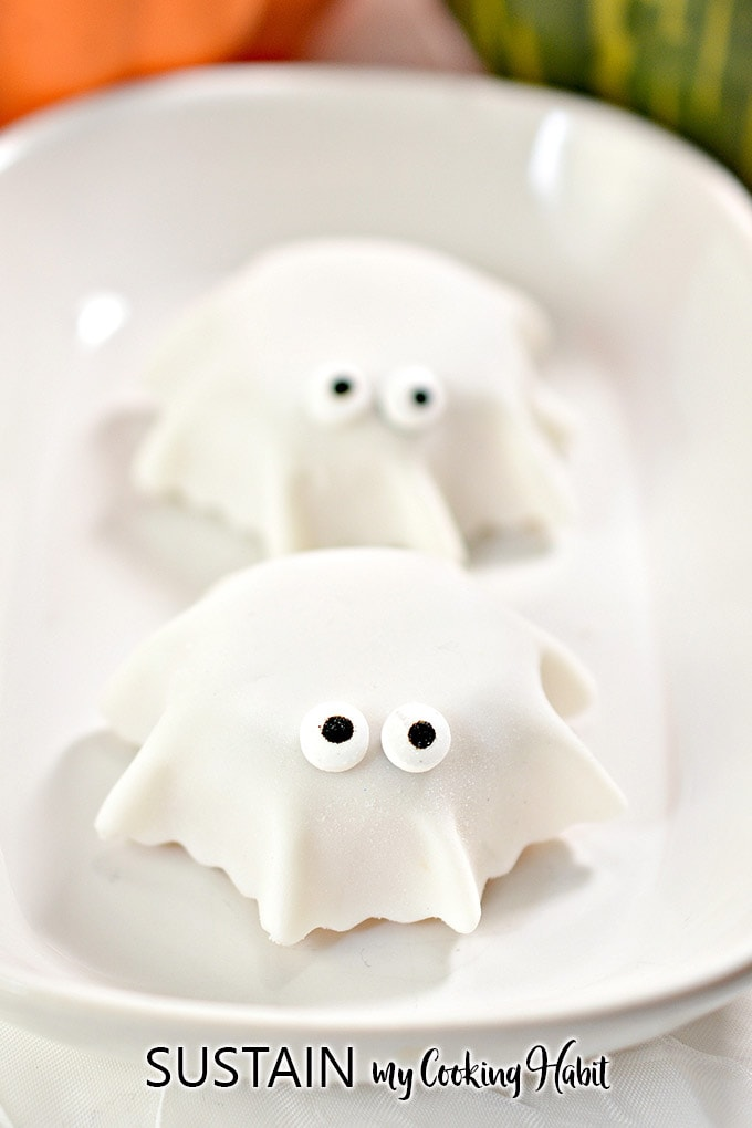 Close up image of one fondant ghost with a second one in the background.