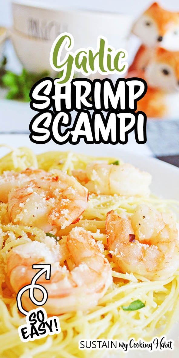 Close up image of cooked garlic shrimp scampi on a bed of spaghetinni pasta.