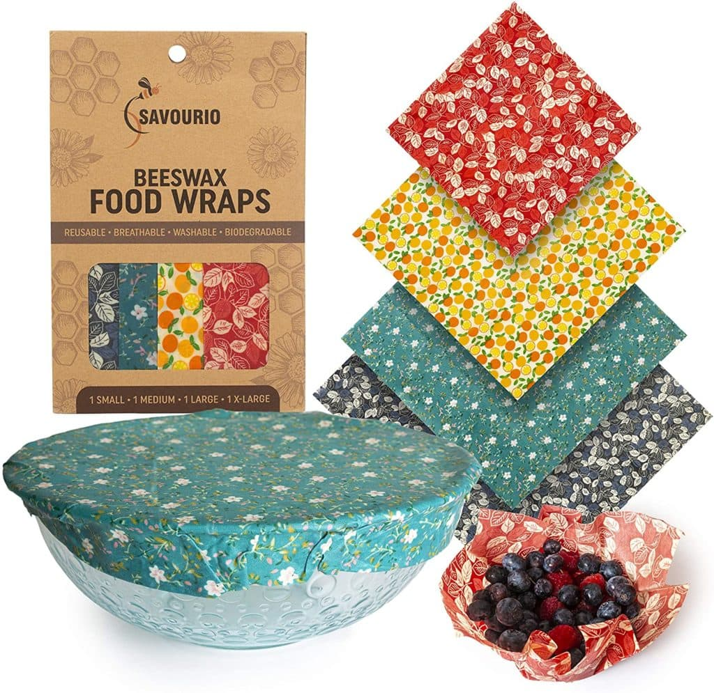 Colorful beeswax food wraps in different sizes, showing that the wraps can be used to cover bowls or hold food.