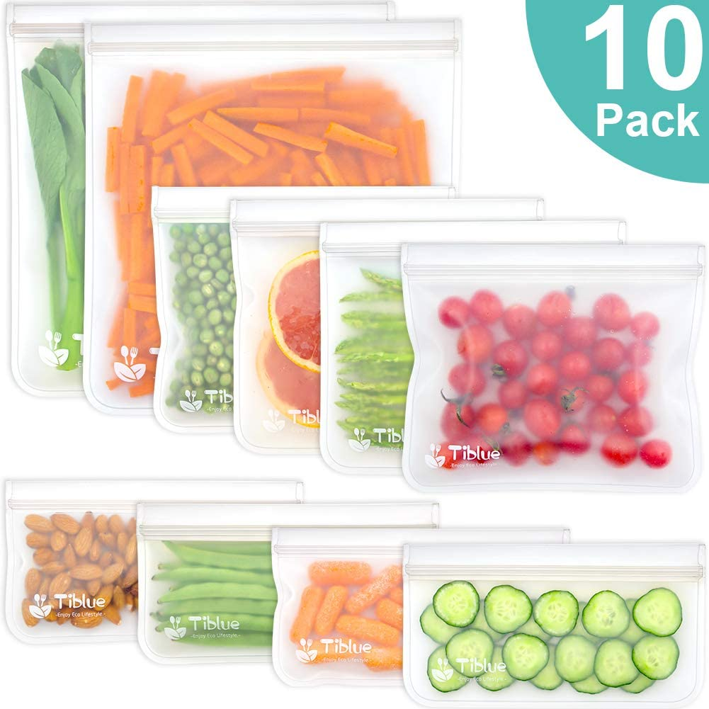A ten pack of reusable freezer bags. Each bag is holding food, such as cucumbers, cherries, carrots, almonds.