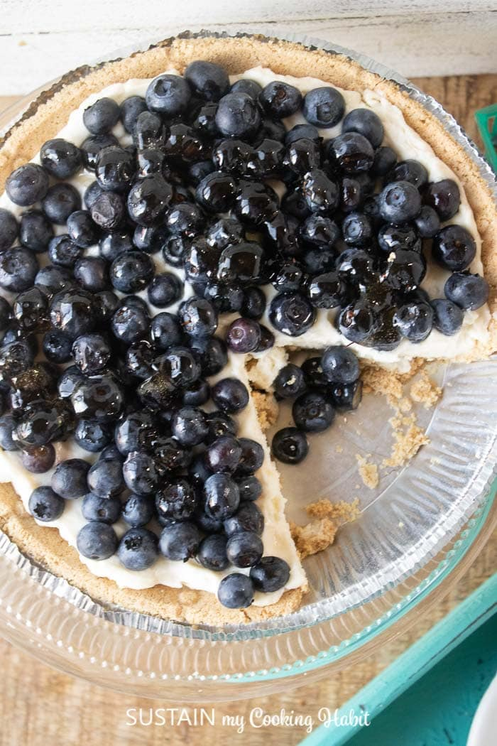 blueberry cream pie with a slice removed