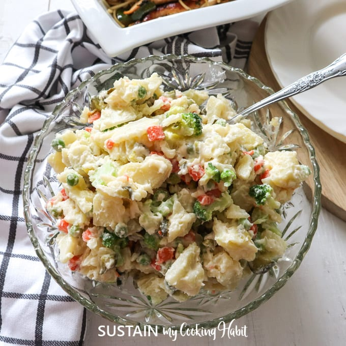creamy and delicious bowl of potato salad with dill pickles