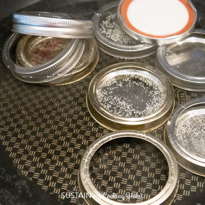 mason jar lids boiling in water for sterilization.