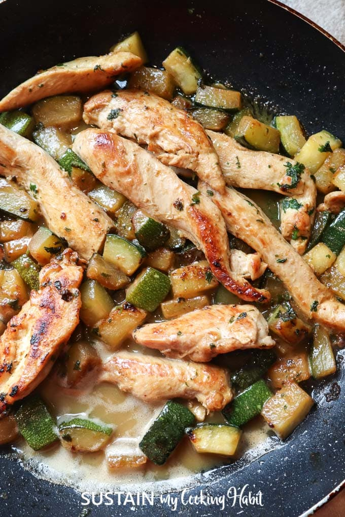 Cooking chicken and zucchini in a non-stick frying pan.
