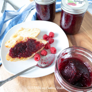 delicious raspberry jam spread over toasted croissant