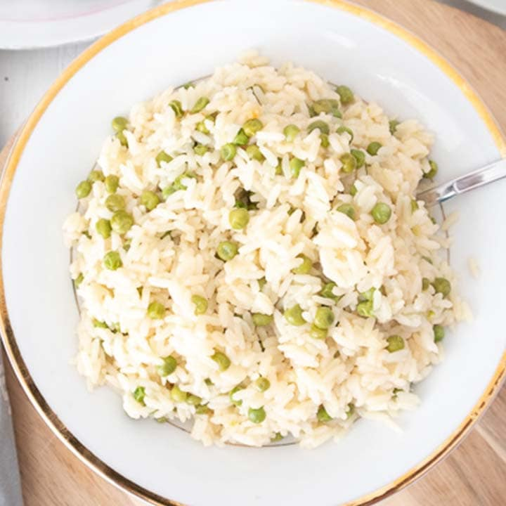 rice and peas in a large serving bowl