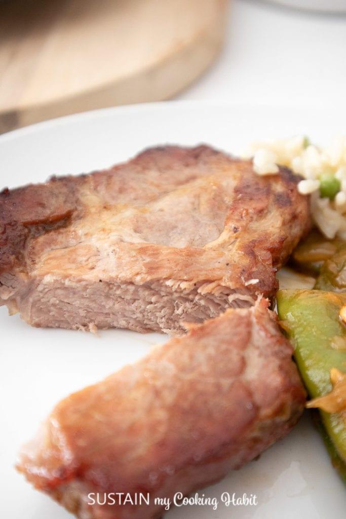 Cut piece of grilled pork shoulder.