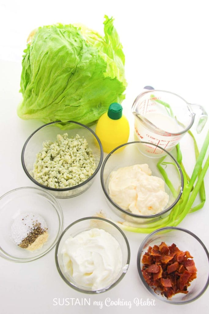 Ingredients in bowls that are needed to make Iceburg wedge salad.