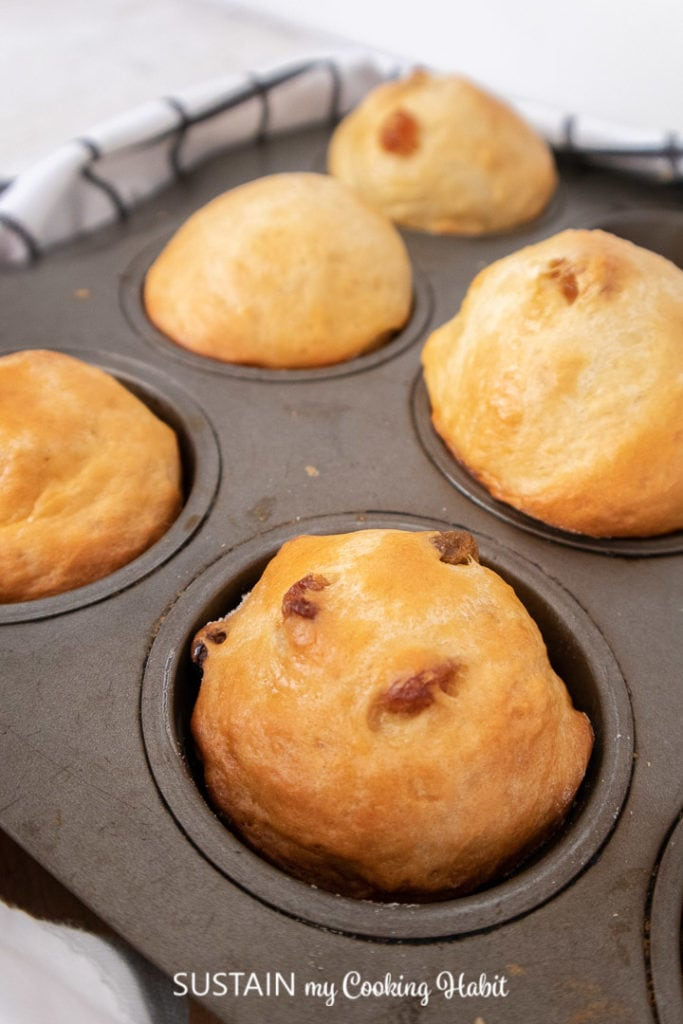 Close up of sweet bread buns in a muffin tin.