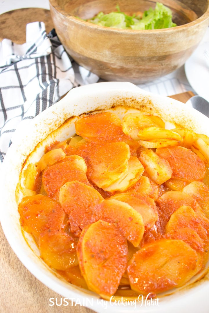 Baked potato and beef casserole in a casserole dish.