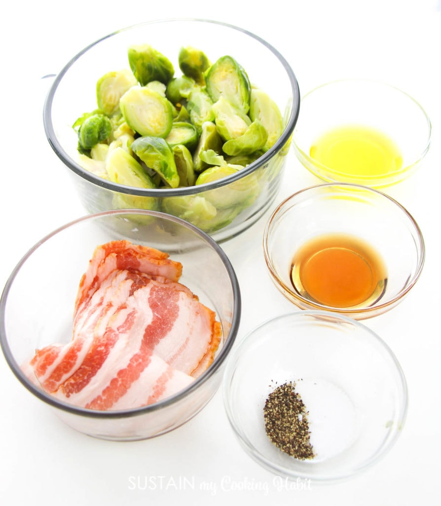 Ingredients in a clear bowls that's needed to make Maple bacon brussel sprouts.