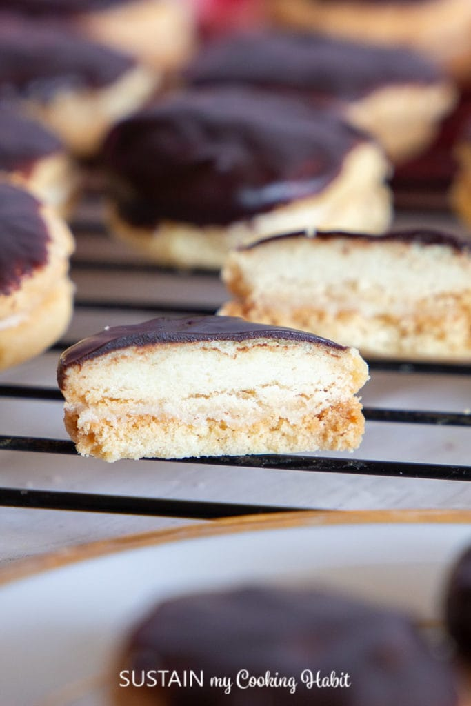delicious sandwich cookies cut in half and placed on cooling rack