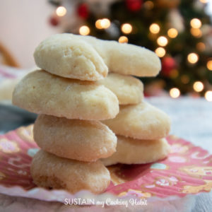 stack of coconut crescent cookies