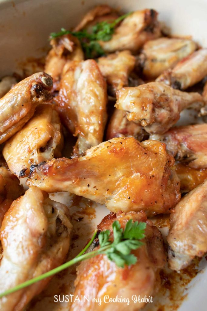 A close up of baked chicken wings.