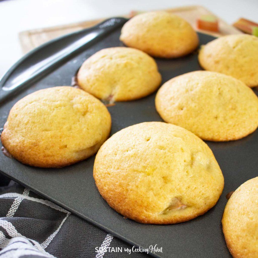 muffinn tray full of freshly baked rhubarb muffins