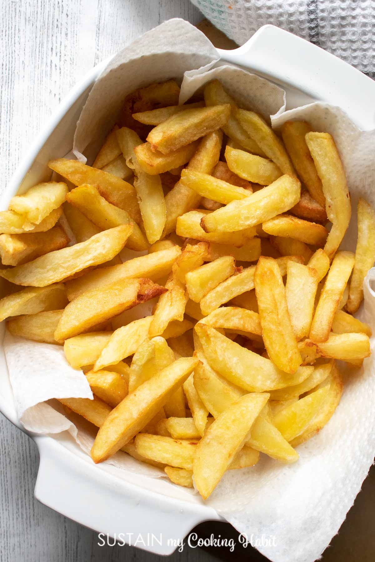 Homemade french fries in a pan.